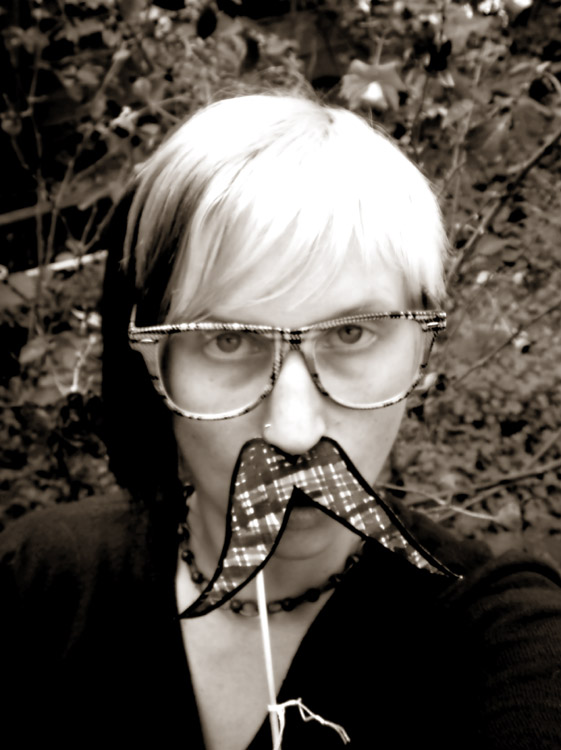 Teal outlaw stache bw web